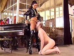 Freaky dude is dominated by vamp leather mistress