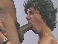 Granny sucking huge chocolate cock