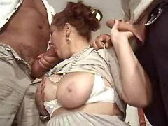 Granny sucks hard cocks by turns