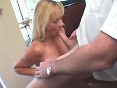 Mature sucks hard cock on kitchen